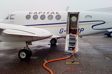 Cleaning inside an aeroplane at Exeter Airport